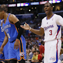 Los Angeles Clippers guard Chris Paul, right, reacts as he is called for a foul on Oklahoma City Thunder guard Russell Westbrook, left, during the second half of an NBA basketball game in Los Angeles, Wednesday, April 9, 2014. The Thunder won 107-101 The