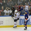 New York Islanders center Frans Nielsen (51) watches Chicago Blackhawks right wing Patrick Kane (88) and fans celebrate Kane's goal in the third period of an NHL hockey game at Nassau Coliseum on Saturday, Dec. 13, 2014, in Uniondale, N.Y. The Islanders w