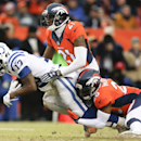 Indianapolis Colts wide receiver T.Y. Hilton, left, is brought down by Denver Broncos free safety Rahim Moore, right, and Aqib Talib (21) during the first half of an NFL divisional playoff football game, Sunday, Jan. 11, 2015, in Denver The Associated Pre