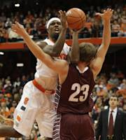 Syracuse's C.J. Fair, left, hits Colgate's Clayton Graham as Fair shoots in the first half of an NCAA college basketball game in Syracuse, N.Y., Saturday, Nov. 16, 2013. (AP Photo/Nick Lisi)