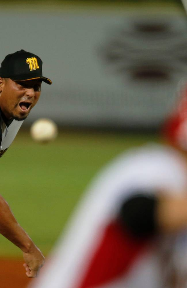 Venezuela's starting pitcher Carlos Zambrano trows the ball during the first inning of a Caribbean Series baseball game against Mexico in Porlamar, Venezuela, Monday, Feb. 3, 2014