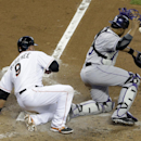 Miami Marlins' Casey McGehee (9) scores as Colorado Rockies catcher Wilin Rosario loses the ball in the third inning of a baseball game, Thursday, April 3, 2014, in Miami The Associated Press