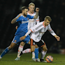 Fulham's Alexander Kacaniklic, right, vies for the ball with Sunderland's Steven Fletcher during the English FA Cup fourth round replay soccer match between Fulham and Sunderland at Craven Cottage stadium in London, Tuesday, Feb. 3, 2015