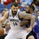Minnesota Timberwolves center Nikola Pekovic (14), of Montenegro, drives against Los Angeles Clippers center DeAndre Jordan (6) during the first quarter of an NBA basketball game in Minneapolis, Monday, March 31, 2014 The Associated Press