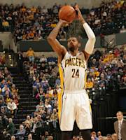 INDIANAPOLIS - JANUARY 4: Paul George #24 of the Indiana Pacers shoots the ball against the New Orleans Pelicans at Bankers Life Fieldhouse on January 4, 2014 in Indianapolis, Indiana. (Photo by Ron Hoskins/NBAE via Getty Images)