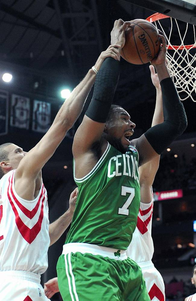 Houston Rockets' Francisco Garcia (32) grabs Boston Celtics' Jared Sullinger (7) in the first half of an NBA basketball game Tuesday, Nov. 19, 2013, in Houston