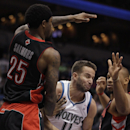 Minnesota Timberwolves guard J.J. Barea (11) protects the ball against the defense of Toronto Raptors guard John Salmons (25) and forward Chuck Hayes (44) in the second half of an NBA basketball game, Sunday, March 9, 2014, in Minneapolis. The Raptors won