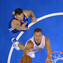 Los Angeles Clippers forward Blake Griffin, below, puts up a shot as Golden State Warriors forward David Lee defends during the first half in Game 1 of an opening-round NBA basketball playoff series, Saturday, April 19, 2014, in Los Angeles The Associated