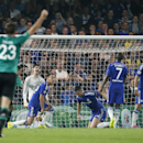 Chelsea's goalkeeper Thibaut Courtois, John Terry and Gary Cahill, from left, react after Schalke's Klaas Jan Huntelaar scored his side's first goal during the Champions League group G soccer match between Chelsea and Schalke 04 at Stamford Bridge stadium