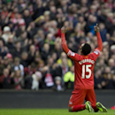 Liverpool's Daniel Sturridge celebrates after scoring his second goal against Swansea City during their English Premier League soccer match at Anfield Stadium, Liverpool, England, Sunday Feb. 23, 2014