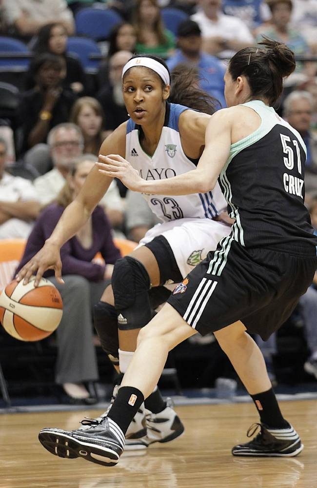 Minnesota Lynx forward Maya Moore (23) drives against New York Liberty guard Anna Cruz (51) during the second half of a WNBA basketball game, Saturday, May 24, 2014, in Minneapolis. Moore scored 30 points as the Lynx won 87-82