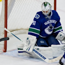 Vancouver Canucks' goalie Eddie Lack, of Sweden, watches as the blade from New York Islanders' Colin McDonald's stick goes flying after breaking during second period NHL hockey action in Vancouver, British Columbia, on Monday March 10, 2014 The Associated