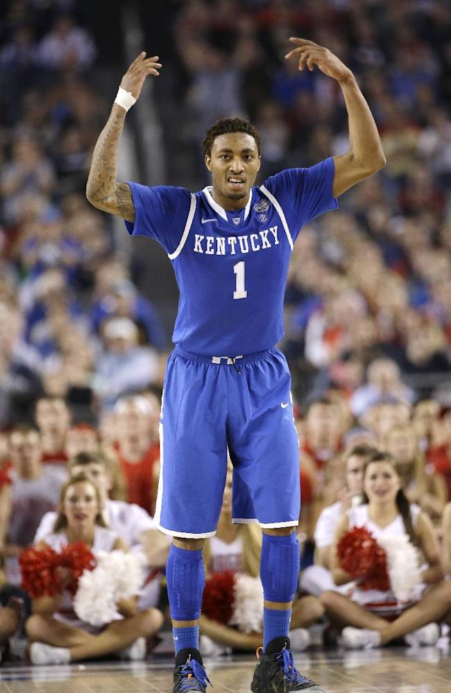 Kentucky guard James Young celebrates during the second half of an NCAA Final Four tournament college basketball semifinal game against Wisconsin Saturday, April 5, 2014, in Arlington, Texas