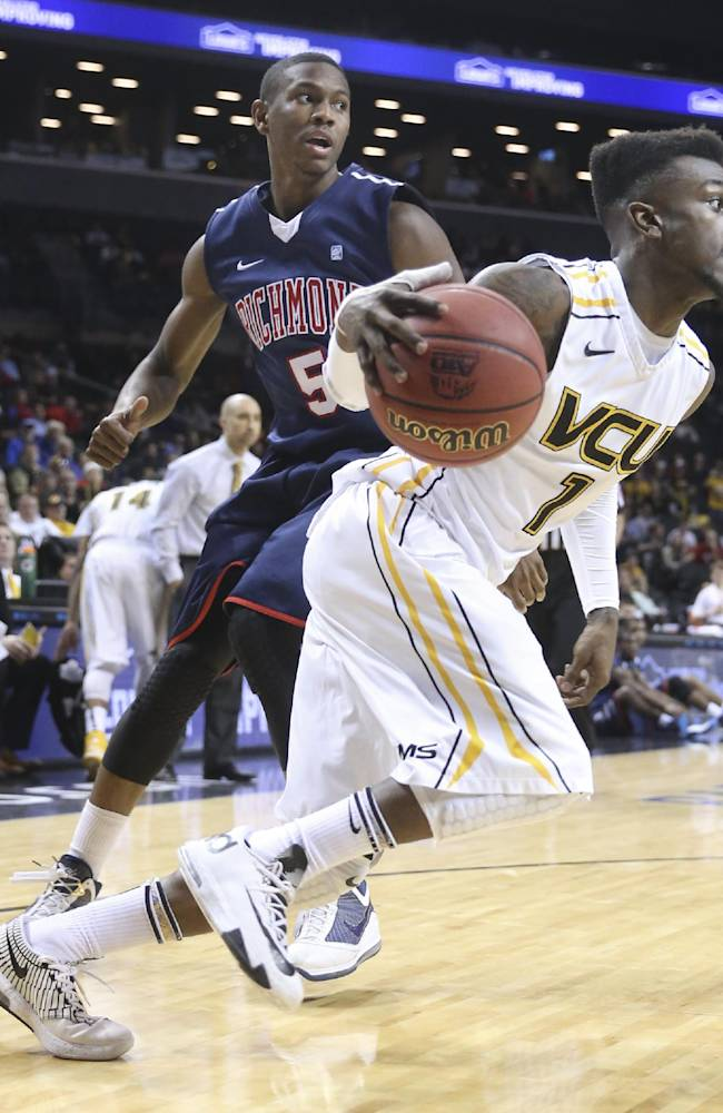 VCU guard Doug Brooks (5) drives past Richmond forward Trey Davis (5) during the second half of an NCAA college basketball game in the quarterfinal round of the Atlantic 10 Conference tournament at the Barclays Center in New York, Friday, March 14, 2014. VCU defeated Richmond, 71-53