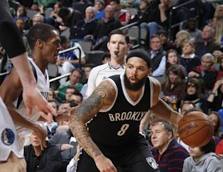 DALLAS, TX - FEBRUARY 28: Deron Williams #8 of the Brooklyn Nets drives against Rajon Rondo #9 of the Dallas Mavericks on February 28, 2015 at the American Airlines Center in Dallas, Texas. (Photo by Danny Bollinger/NBAE via Getty Images)