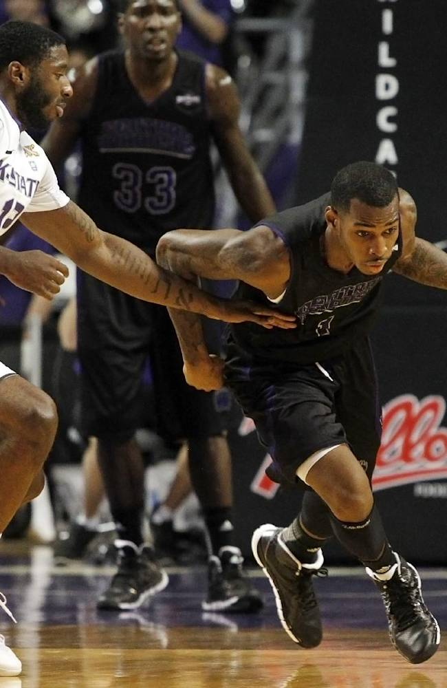 Kansas State's Omari Lawrence, left, pressures Central Arkansas' DeShone McClure, right, during the first half of an NCAA college basketball game in Manhattan, Kan, Sunday, Dec. 1, 2013