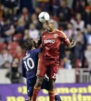 Real Salt Lake defender Chris Schuler, right, heads the ball as Chivas USA midfielder Eric Torres defends in the first half of an MLS soccer game Wednesday, Oct. 23, 2013, in Sandy, Utah. (AP Photo/Rick Bowmer)