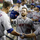 New York Mets' Anthony Recker (20) gets a handshake from bench coach Bob Geren, right, and a high-five from teammate Ike Davis, after Recker hit a home run against the Arizona Diamondbacks during the second inning of a baseball game on Wednesday, April 16