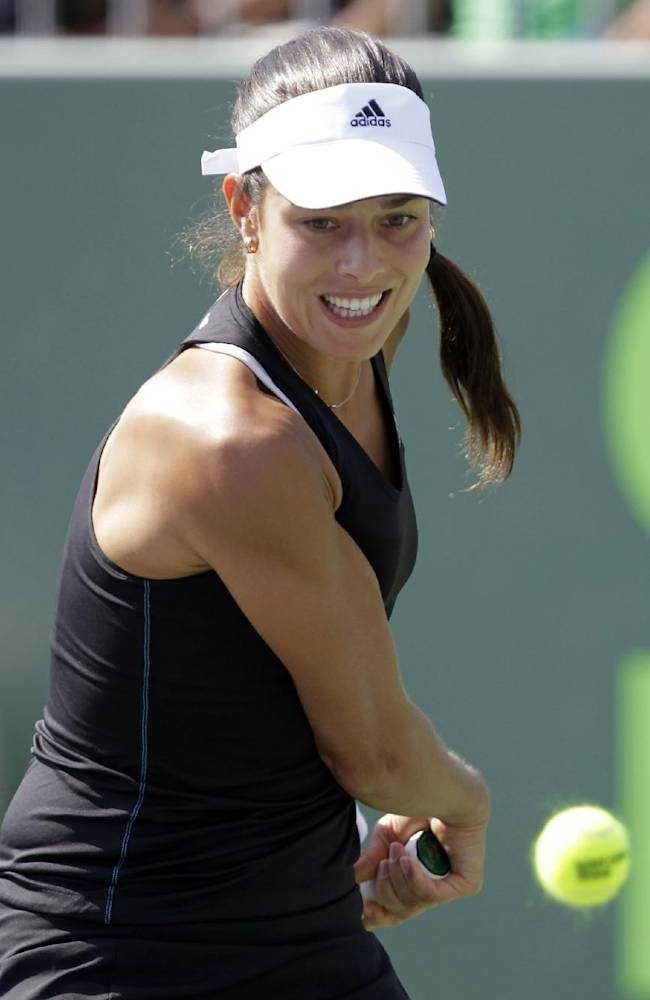 Ana Ivanovic, of Serbia, returns the ball to Petra Kvitova, of Czech Republic, during the Sony Open tennis tournament, Monday, March 24, 2014, in Key Biscayne, Fla