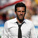 D.C. United head coach Ben Olsen walks of the field after an MLS soccer match against the New York Red Bulls, at RFK Stadium, Sunday, Aug. 31, 2014, in Washington. United won 2-0. The Associated Press
