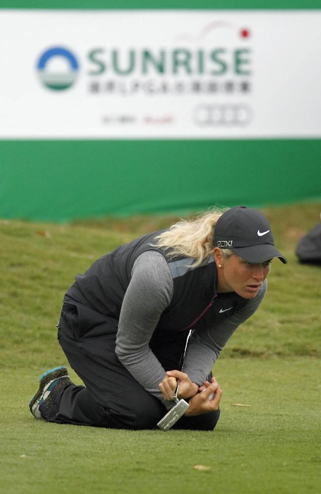Suzann Pettersen of Norway lines up her shot on the 18th green during the first day of the Sunrise LPGA Taiwan Championship golf tournament at the Sunrise Golf & Country Club, Thursday, Oct. 24, 2013, in Yangmei, northeastern Taiwan. Pettersen finished in first position after carding a 68 with four strokes under par