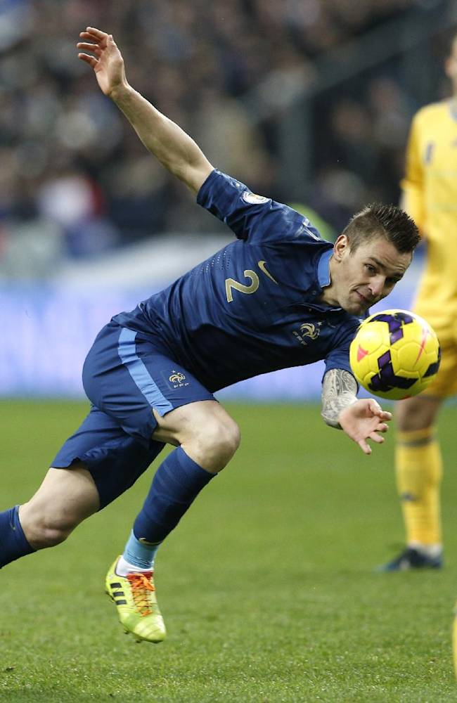 Mathieu Debuchy, of France, eyes the ball during the World Cup qualifying playoff second-leg soccer match between France and Ukraine at Stade de France stadium in Saint Denis, outside Paris, Tuesday, Nov. 19, 2013