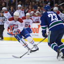 Montreal Canadiens' Manny Malhotra (20) skates up ice with the puck as Vancouver Canucks' Alexander Edler, of Sweden, defends during the first period of an NHL hockey game, Thursday, Oct. 30, 2014 in Vancouver, British Columbia The Associated Press