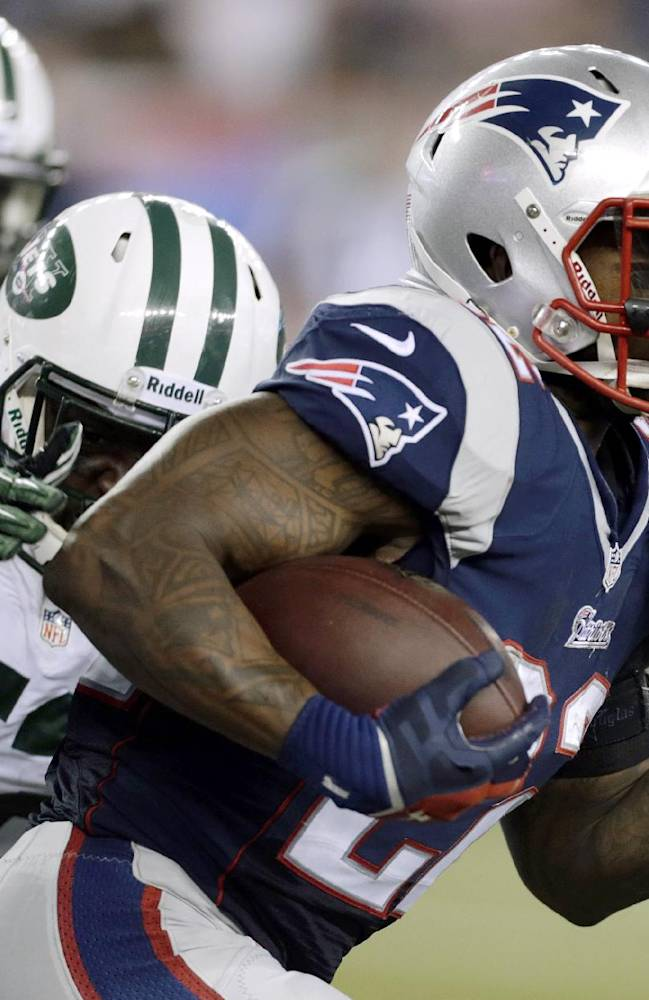 New England Patriots running back Stevan Ridley (22) runs past New York Jets inside linebacker David Harris (52) during the first half of an NFL football game Thursday, Sept. 12, 2013, in Foxborough, Mass