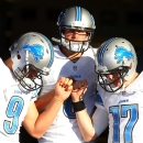 Detroit Lions quarterbacks Matthew Stafford (9), Dan Orlovsky (8) and Kellen Moore (17) huddle before taking the field for warm ups before a preseason NFL football game against the Buffalo Bills, Thursday, Aug. 28, 2014, in Orchard Park, N.Y The Associate