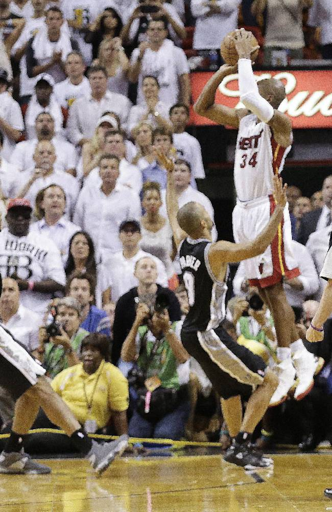 FILE - In this June 19, 2013, file photo, Miami Heat's Ray Allen (34) shoots a 3-point basket in the final seconds of regulation of Game 6 of the NBA Finals basketball game against the San Antonio Spurs in Miami. Allen's shot sent the game into overtime. Rematches aren't exactly rare in the NBA Finals, with the Warriors-Cavaliers series set to become the 14th in league history. Teams that lost one season and then got their rematch have managed to atone for the loss in seven of the previous 13 instances. (AP Photo/Lynne Sladky, File)