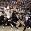 Toronto Raptors guard Terrence Ross (31) and Brooklyn Nets forward Andrei Kirilenko (47) collide while chasing a loose ball during the first half of Game 2 in an NBA basketball first-round playoff series, Tuesday, April 22, 2014, in Toronto The Associated
