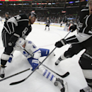 Los Angeles Kings right wing Justin Williams, left, and ddefenseman Brayden McNabb, right, battles Toronto Maple Leafs right wing Troy Bodie for the puck during the first period of an NHL hockey game in Los Angeles, Monday, Jan. 12, 2015 The Associated Pr