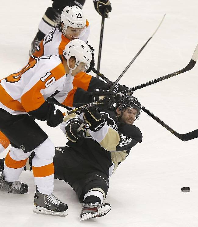Philadelphia Flyers' Brayden Schenn (10) and Luke Schenn (22) chase after the puck with Pittsburgh Penguins' Brian Gibbons (49) during the third period of an NHL hockey game on Sunday, March 16, 2014, in Pittsburgh. The Flyers won 4-3