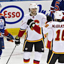 Calgary Flames' Kevin Westgarth (15) and Brian McGrattan (16) celebrate a goal as Edmonton Oilers' Oscar Klefbom (84) skates past during the third period of an NHL hockey game Saturday, March 22, 2014, in Edmonton, Alberta The Associated Press