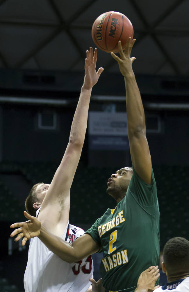 George Mason forward Johnny Williams (2) puts up a shot over St. Mary's center Matt Hodgson (33) in the first half of an NCAA college basketball game at the Diamond Head Classic  Wednesday, Dec. 25, 2013, in Honolulu