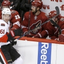 Ottawa Senators' Mark Stone (61) accidentally hits his brother, Arizona Coyotes' Michael Stone (26), with a stick during the third period of an NHL hockey game Saturday, Jan. 10, 2015, in Glendale, Ariz. The Senators defeated the Coyotes 5-1 The Associat