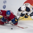Montreal Canadiens' Alex Galchenyuk, left, and Buffalo Sabres' Drew Stafford vie for the puck during the first period of an NHL hockey game Tuesday, Feb. 3, 2015, in Montreal The Associated Press