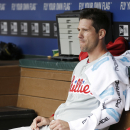 Philadelphia Phillies starting pitcher Cliff Lee sits in the dugout during the second inning of an opening day baseball game against the Texas Rangers at Globe Life Park, Monday, March 31, 2014, in Arlington, Texas The Associated Press