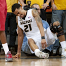 Missouri's Laurence Bowers struggles to get off the ground after he injured his knee during the second half of an NCAA college basketball game against Alabama on Tuesday, Jan. 8, 2013, in Columbia, Mo. Missouri won the game 84-68. Bowers did not return to the game. (AP Photo/L.G. Patterson)