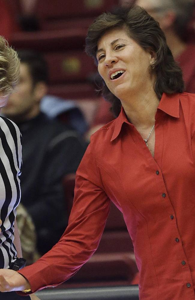 New Mexico head coach Yvonne Sanchez, right, talks to official Melissa Barlow during the first half of an NCAA college basketball game in Stanford, Calif., Monday, Dec. 16, 2013. Stanford won 75-41