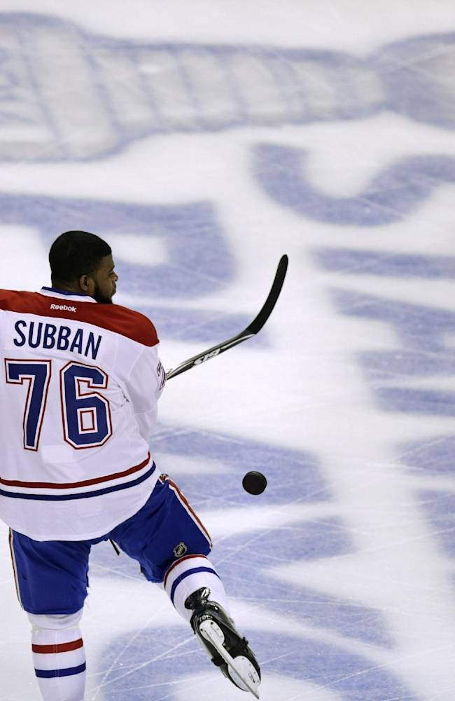 Montreal Canadiens defenseman P.K. Subban kicks the puck off his skate while warming up before facing the Boston Bruins in Game 5 of the second-round of the Stanley Cup hockey playoff series in Boston, Saturday, May 10, 2014