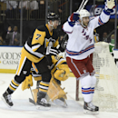 New York Rangers center Derick Brassard (16) celebrates the goal scored by left wing Rick Nash as Pittsburgh Penguins defenseman Paul Martin (7) reacts in the second period of an NHL hockey game at Madison Square Garden on Monday, Dec. 8, 2014, in New Yo