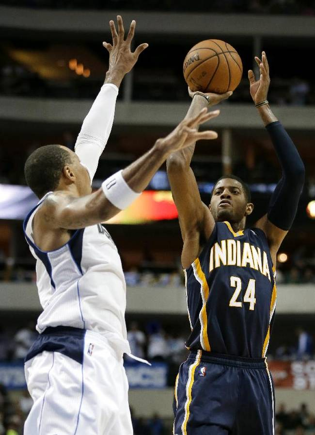 Dallas Mavericks' Shawn Marion, left, defends against a shot attempt by Indiana Pacers' Paul George in the second half of a preseason NBA basketball game, Friday, Oct. 25, 2013, in Dallas