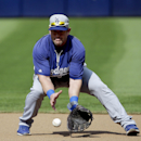 Los Angeles Dodgers' Nick Punto fields a ball during baseball practice, Wednesday, Oct. 2, 2013, in Atlanta. The Dodgers play the Atlanta Braves in Game 1 of the National League Division Series in Atlanta on Thursday The Associated Press