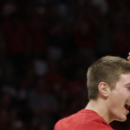 Wisconsin forward Sam Dekker, right, celebrates with teammates after beating Arizona 85-78 in a college basketball regional final in the NCAA Tournament, Saturday, March 28, 2015, in Los Angeles. Wisconsin will play in the Final Four in Indianapolis. (AP Photo/Jae C. Hong)