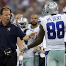 Dallas Cowboys head coach Jason Garrett, front left, talks with wide receiver Dez Bryant (88) who walks off the field during the second half of an NFL football game against the San Francisco 49ers, Sunday, Sept. 7, 2014, in Arlington, Texas The Associated