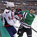 Washington Capitals left wing Alex Ovechkin (8) and Dallas Stars left wing Ryan Garbutt (16) tangle during the first period of an NHL hockey game Saturday, Jan. 17, 2015, in Dallas The Associated Press
