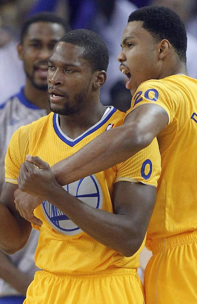 Golden State Warriors guard Toney Douglas (0) celebrates with guard Kent Bazemore (20) after making a three-point shot in the final seconds of the first half against the Los Angeles Clippers in an NBA basketball game, Wednesday, Dec. 25, 2013, in Oakland, Calif