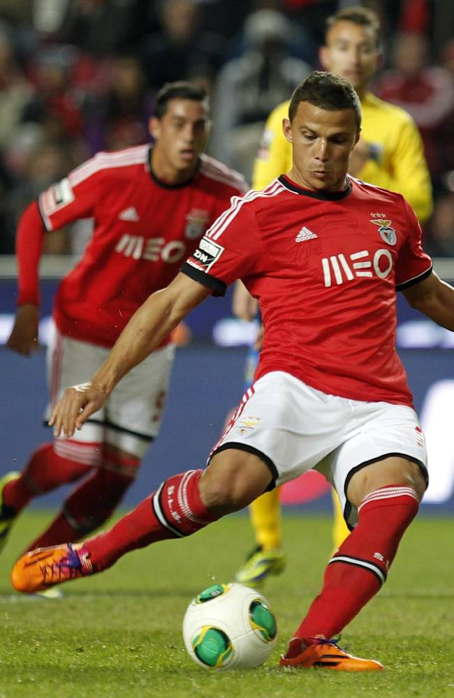 Benfica's Lima, from Brazil, shoots the ball to score a penalty kick during a Portuguese league soccer match between Benfica and Arouca at Benfica's Luz stadium in Lisbon, Friday, Dec. 6, 2013. Lima scored once and the match ended in a 2-2 draw