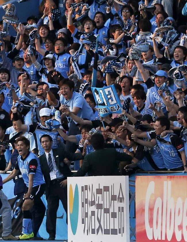 Kawasaki Frontale's Yoshito Okubo, bottom  left, celebrates after scoring a goal against Gamba Osaka during a J-League soccer match in Kawasaki, near Tokyo, Saturday, April 26,  2014